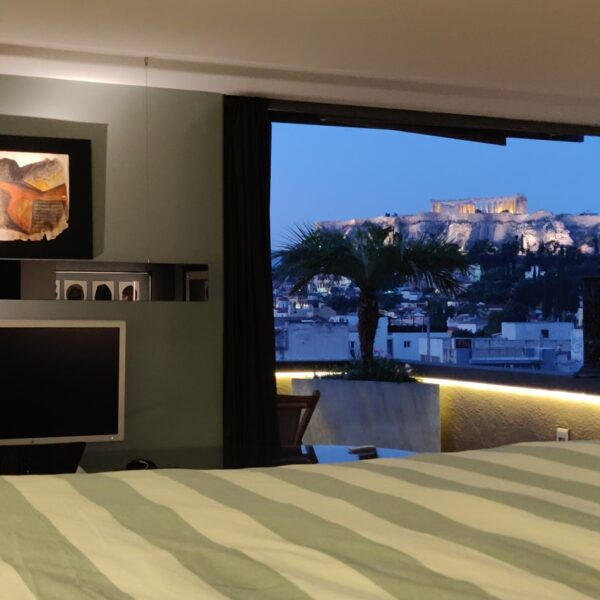 Penthouse Acropolis view from the bed in the evening